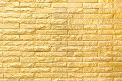 Gouden bakstenen muur achtergrondpatroontextuur Stock Foto's