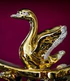 Gouden beeldje van zwaan stock fotografie