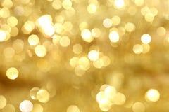 Gouden bokeh royalty-vrije stock afbeeldingen