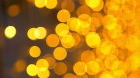 Gouden bokehachtergrond heel wat gouden onscherpe lichten royalty-vrije illustratie
