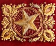 Gouden borduurwerk op een stof royalty-vrije stock afbeeldingen