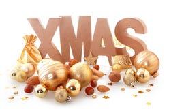 Gouden Bruine Kerstmisornamenten op Wit Royalty-vrije Stock Fotografie