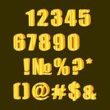 Gouden cijfers aangaande een donkerblauwe achtergrond Stock Foto's