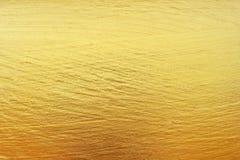 Gouden de textuur abstracte achtergrond van lijnenpatronen stock foto's