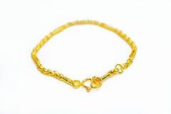 Gouden die armband op wit wordt geïsoleerd Royalty-vrije Stock Fotografie