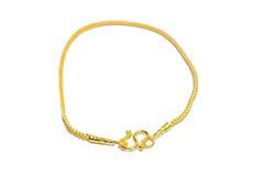 Gouden die armband op wit wordt geïsoleerd Royalty-vrije Stock Foto