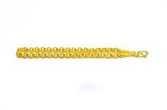 Gouden die armband op wit wordt geïsoleerd Stock Afbeelding