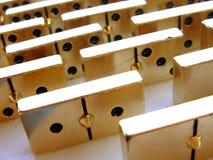 Gouden domino stock afbeelding