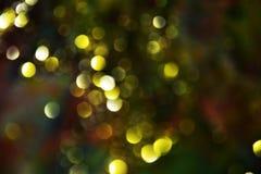 Gouden donkere cirkellichten kleurrijke tinten, achtergrond, bokeh Stock Afbeeldingen
