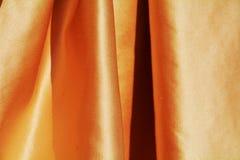 Gouden elegante vouwen, achtergrond Stock Foto