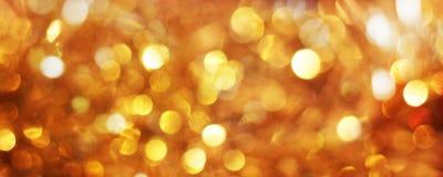 Gouden en gele bokehkerstmis als achtergrond Stock Fotografie