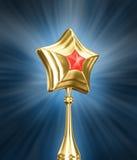 Gouden en rode ster op zwarte achtergrond Stock Fotografie