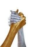 Gouden en zilveren aangesloten bij handen Stock Afbeeldingen