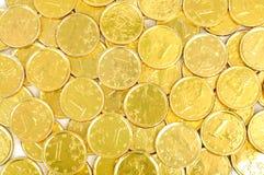 Gouden euro muntstukkenachtergrond stock foto's