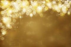 Gouden feestelijke achtergrond Abstract gouden licht, uitstraling Stock Afbeeldingen