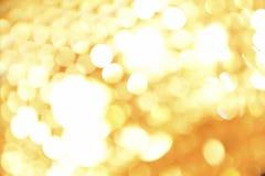 Gouden feestelijke lichtenachtergrond Stock Afbeelding