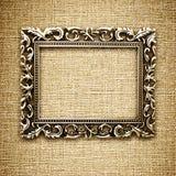 Gouden frame op een canvasachtergrond stock afbeelding