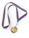 Gouden geïsoleerded medaille stock foto