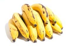 Gouden gele gescheurde banaan met sommige vlekken op witte B stock foto's