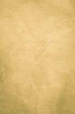 Gouden geschilderde textuur als achtergrond met parelachtige flikkering royalty-vrije stock afbeeldingen