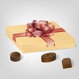 Gouden giftdoos van chocoladesuikergoed Royalty-vrije Stock Afbeeldingen