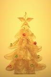 Gouden, gloeiende Kerstmisboom Stock Fotografie