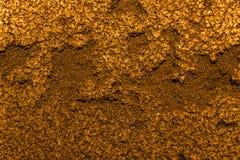 Gouden goudklompje als achtergrond Stock Afbeelding