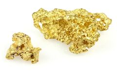 Gouden goudklompjes stock fotografie