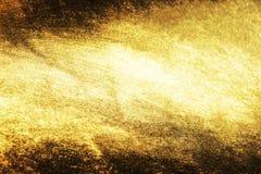 Gouden grungeachtergrond of textuur en gradiëntenschaduw Stock Foto's