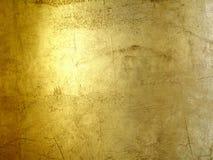 Gouden grungeachtergrond van huren Stock Foto