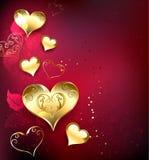 Gouden harten op een rood royalty-vrije stock foto
