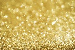 Gouden het knipperen van Kerstmis achtergrond Royalty-vrije Stock Afbeeldingen