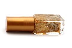 Gouden horizontaal spijkerpoetsmiddel Stock Fotografie