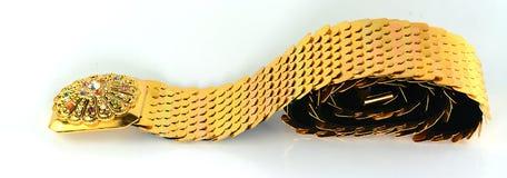 Gouden juwelen, armbanden en kettingen stock fotografie