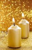 Gouden kaarsen Gouden schitterende Kerstmislichten Stock Fotografie