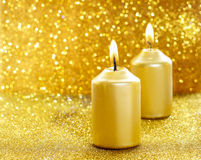 Gouden kaarsen Gouden schitterende Kerstmislichten Stock Foto