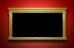 Gouden Kader op Galerijmuur royalty-vrije stock afbeeldingen