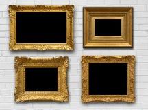 Gouden Kaders op Muur Stock Afbeeldingen