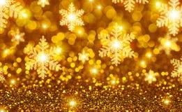 Gouden Kerstmisachtergrond stock afbeeldingen