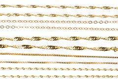 Gouden kettingen stock fotografie