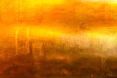 Gouden kleuren grunge achtergrond Royalty-vrije Stock Foto's