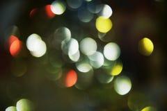Gouden kleurrijke zilveren donkere cirkellichten in pastelkleur kleurrijke tinten, achtergrond, bokeh Royalty-vrije Stock Foto's