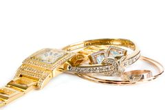 Gouden klok en juwelen Royalty-vrije Stock Fotografie