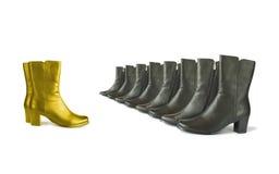 Gouden (leider) en zwarte (team) laarzen Royalty-vrije Stock Afbeeldingen