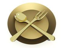 Gouden lepel en vork op plaat Royalty-vrije Stock Foto's