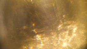 Gouden lichte abstracte gevolgen voor bekledingsdoel stock video