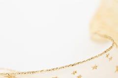 Gouden lintachtergrond Stock Afbeelding