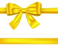 Gouden linten met boog op wit Royalty-vrije Stock Afbeeldingen