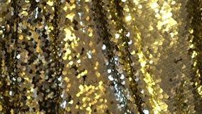 Gouden lovertjespan stock footage