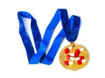 Gouden medaille en pillen royalty-vrije stock fotografie